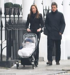 Family day:Hugh Grant was spotted out in London with Swedish girlfriend Anna Eberstein and their baby daughter on Saturday following the success of the 10-minute sequel