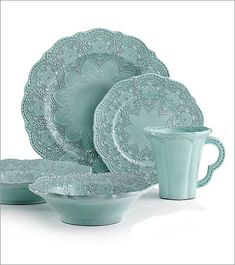 Arte Italica Merletto Aqua 5-Piece Placesetting: A delicate blue glaze, a rich, black clay and a vintage lace pattern blend beautifully to create this stunning placesetting. Includes Dinner  Plate (10.75