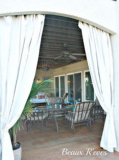 outdoor curtains from drop cloths and rods from plumbing pieces