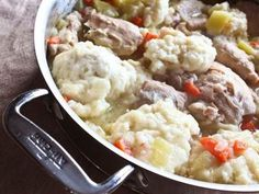 Cozy up with a soothing bowl of classic chicken and dumplings