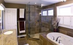 Slate tile in the bathroom and shower.  Plus a window in the shower. Perfect.