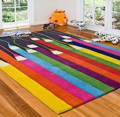 crazy colour color floor rug pencil and black and rainbow childs room