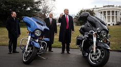 White House Chief of Staff Reince Priebus and Vice President Mike Pence look on as President Donald Trump speaks briefly to reporters after greeting Harley Davidson executives on the South Lawn of the White House, February 2, 2017 in Washington, DC.