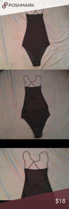 "Brandy Melville Black Bodysuit Brandy Melville Black strappy bodysuit. Worn once. ""One size fits all"" Ribbed texture. Backless and super cute! I'm on the shorter side and it is just a little too long for my short torso😜 Wish it fit! Brandy Melville Tops"
