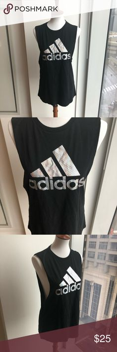Adidas Iridescent Muscle Tank NWOT Adidas Women's Badge of Sport Iridescent Muscle Tank • size M • NWOT • originally from Nordstrom • sleek sleeveless black tank that flashes an iridescent adidas Badge of Aport across the chest • round crew neck • lightweight tee made of a soft cotton blend • perfect for performance in the gym but stylish for everyday wear • climalite technology to wick away moisture • bundle & save! adidas Tops Muscle Tees