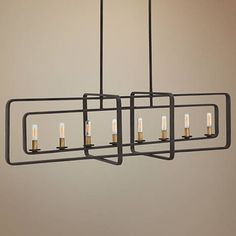 This handsome, contemporary island chandelier features eight lights set within four buckeye bronze geometric forms.