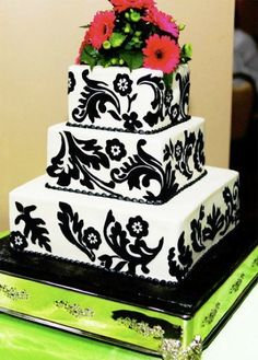 Keep wedding cake costs down! Instead of decorative fondant which can add up quickly, cut pieces of fabric yourself to give to your decorator to put on the cake! Can't tell the difference in this picture and neither will your guests!