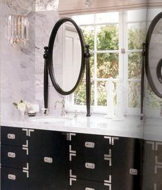 Splendor in the Bath. Mirrors in front of windows. Campaign style vanity. Interior Designer: Kelly Wearstler.