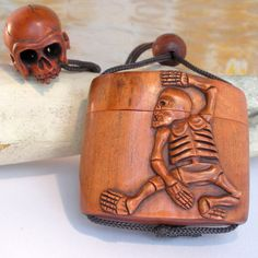 The wife would love this. Carved Skeleton and Skull Netsuke Box      From thecuriousbead