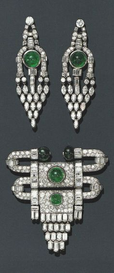 VAN CLEEF & ARPELS - AN ART DECO EMERALD AND DIAMOND DEMI PARURE, CIRCA 1930. Comprising a brooch and a pair of earrings, mounted in platinum, with French assay and maker's marks. Source: Christie's, Magnificent Jewels, NY, April 2000.