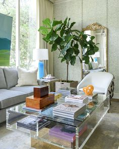 Living Room Design With Lucite And Brass Coffee Table