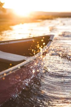 (TRAVEL) I love the movement of the water and how the sun is catching the droplets as they splash up along the side of the canoe. Such a beautiful photo.