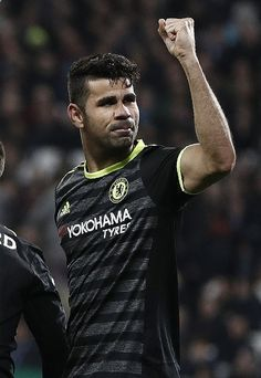 Chelseas Brazilian-born Spanish striker Diego Costa celebrates scoring his teams second goal during the English Premier League football match between West Ham United and Cheslsea at The London Stadium in east London on March 6, 2017. / AFP PHOTO / Adrian DENNIS / RESTRICTED TO EDITORIAL USE. No use with unauthorized audio, video, data, fixture lists, club/league logos or live services. Online in-match use limited to 75 images, no video emulation. No use in betting, games or single club...