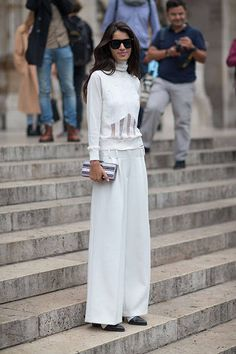 Sheer panels added a modern twist to this classic all white ensemble #StreetStyle Paris Fashion Week Spring 2014