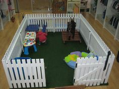 Love this playpen! Fake grass and white picket fence