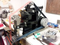 Belt Grinder by sanch -- Homemade 2x72 belt grinder fabricated from steel. Features an adjustable platen to allow for slack grinding. http://www.homemadetools.net/homemade-belt-grinder-47