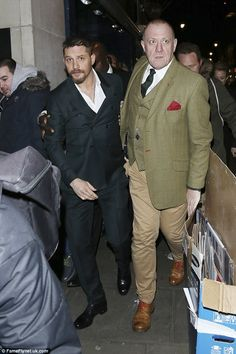 Protection: The star looked to have stepped up security as he was escorted out of the nigh...