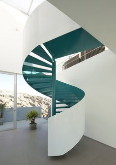 Riofrio+Rodrigo Architects spiral turquoise stair. There's always something elegant about a spiral stair.