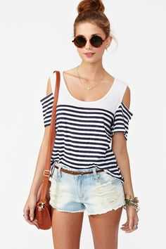 Lovely, simple summer outfit. Loose striped tee tucked into denim cut-off shorts with a brown belt