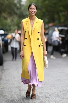 100 best dressed of 2014 - Caroline Issa in a longline bright yellow vest over a pink maxi dress + leopard sandals with gold chain ankle strap
