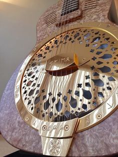 The Runes guitar commissioned by JJ of Kaleo. Gold-plated and engraved with Icelandic runes, a Vegvisir and JJ's signature Icelandic Runes, Resonator Guitar, Vegvisir, Unique Guitars, Guitar Parts, Electric Guitars, Music Love, Famous Faces, Musical Instruments