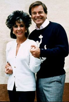 "Elizabeth Taylor and Robert Wagner team up in the TV movie ""There Must Be A Pony,"" 1986. They are seen here during a break in filming"