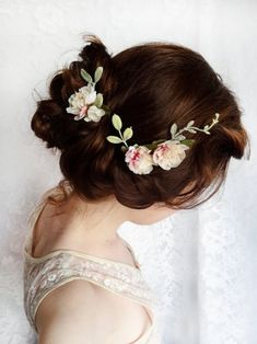 Twisted updo with flowers.