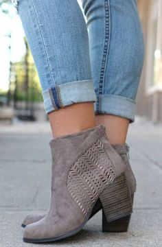 "Must have taupe booties. Striking cut out design. 3"" heel. Back zipper.:"