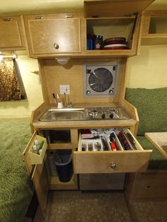 If we were keeping the kitchenette, I would want it to be as shiney & organized as this. (And, look! Another bed + front dinette combo!)