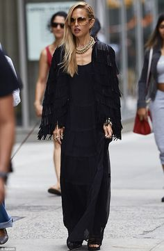 Black beauty: Her outfit looked remarkably similar to the one she had worn the previous ev...
