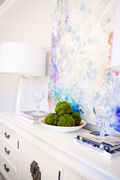 Buffet vignette with large abstract art