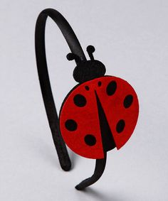 When her locks are unruly and you're running late to a play date at the park, this headband is perfect for pulling back her locks out of her eyes. Delightfully girly with fun and funky ladybug appliqués, she'll look effortlessly put together—no need to even brush out the snarls.   •80% plastic / 20% felt •Recommended for ages three years and older  •Imported