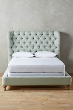 Linen Tufted Wingback Bed - anthropologie.com