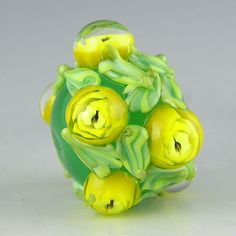 a floral focal in green alabaster with delicate yellow rosebuds and green leaves handmade lampwork glass bead - Yellow Roses