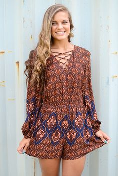 Boho vibes for the ultimate boho babe...you! This rust colored printed romper by…