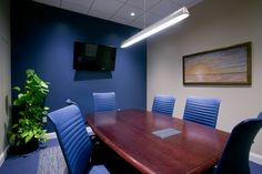 commercial conference room  #commericial #design #interiordesign #buissness #conferenceroom #hhi #henriettaheisler #chairs #blue #paint #accentwall #meetings #conferencetable #table #plants #lights #painting #accentwall