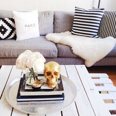 theme? Living room chic in gray black and white gold (other gold object the skull is a little creepy),sheepskin