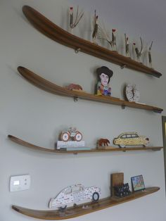 Howard Finster and Minnie Adkins folk art displayed on repurposed vintage wooden ski shelves