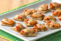 Here's another winner from our Healthy Living recipe developers: crunchy crackers stacked with saucy chicken, cheese and oregano.