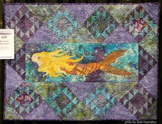"Swimming Upstream, 44 x 33"", by Naida Koraly (North Carolina). 2016 AQS QuiltWeek.  Photo by Quilt Inspiration."