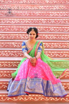 Sampradaya - 027Life is Short Make every outfit Count !!!Beautiful pink color pattu lehenga and royal blue color blouse with green color net dupatta. Blouse with elephant design hand embroidery gold thread work.  For orders/queries Call/ what's app us on8341382382 orMail us tejasarees@yahoo.com 31 March 2018 Half Saree Designs, Choli Designs, Lehenga Designs, Blouse Designs, Blouse Styles, Lehenga Crop Top, Half Saree Lehenga, Sari, Saree Blouse