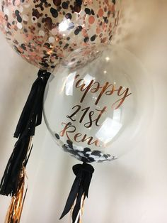 60cm helium filled confetti balloons with custom confetti for a 21st birthday in rose gold and black with personalised bubble balloons