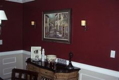 An example of Behr Velvety Merlot done in a dining area, pictures of the paint color on walls shows much more red hues than the paint swatch