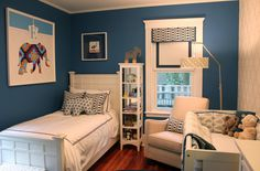 liking this nursery for a baby boy, with the dark blue walls and the cool accent wall, and the geometric patterns throughout.