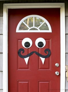 Mustache and Googly Eyes Door Decor: If you're like me and want to keep your Halloween decorations simple and quick, then this is the perfect DIY for you.