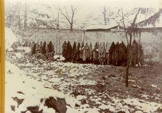 Dachau, Germany, Inmates' clothes hanging on a rope outside the crematorium building.