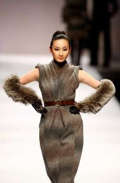A model parades the latest knitwear collection from young Chinese designers at the China Fashion Week 2009 in Beijing on March 26, 2009. Description from intellasia.net. I searched for this on bing.com/images
