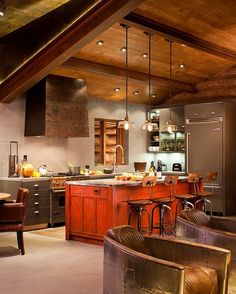 Beautiful Rustic Chic Kitchen...love the pop of red on the Island!