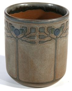 Wonderful wide mouth vessel with Arts & Crafts stylized fruit trees.  Gray background; blue/gray trees with darker blue berries and green leaves outlined in brown and brown interior.  Impressed ship mark and artist signed B within a circle.  Excellent original condition.  4 H x 3 1/4 W.