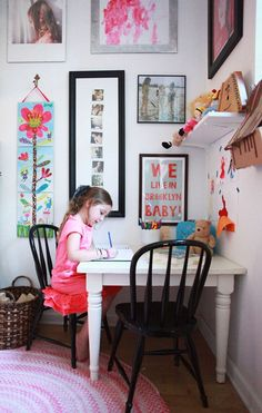 Even a kid's playroom should be decorated! Art and memories should definitely be framed for this space, but don't forget to frame your child's artwork, too! | Design Sponge